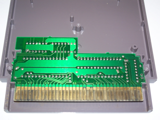 An un-cleaned NES game motherboard with oxidized contacts.