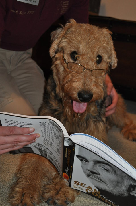 Hyacinth catching up on some light reading. Sean Connery is her favorite actor.