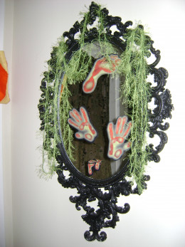 Mirror inside the house. Draped with fuzzy yarn.
