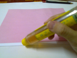 glue the pink paper on top of the white card
