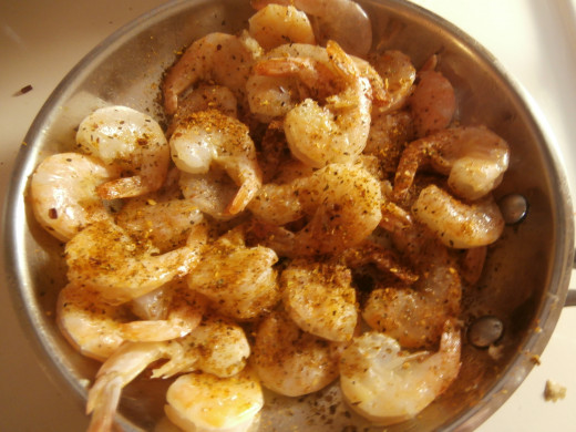 Add as much Cajun spice as you like and fry until the shrimp are pink.