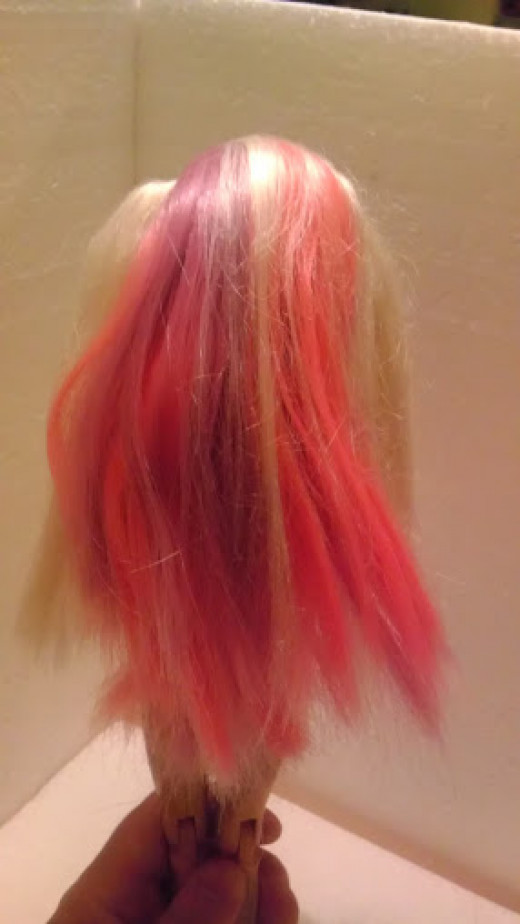 Terribly unattractive pink and purple Barbie hair...