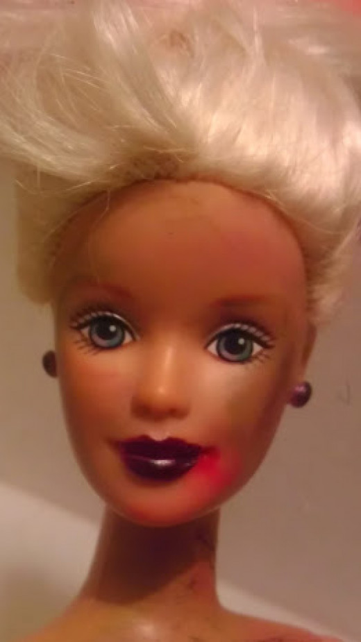 Darker lipstick with red in the corner of Barbie's mouth signifies a freshly eaten meal. Light blue smudges create bruises easily.  Green smudges catch the light.