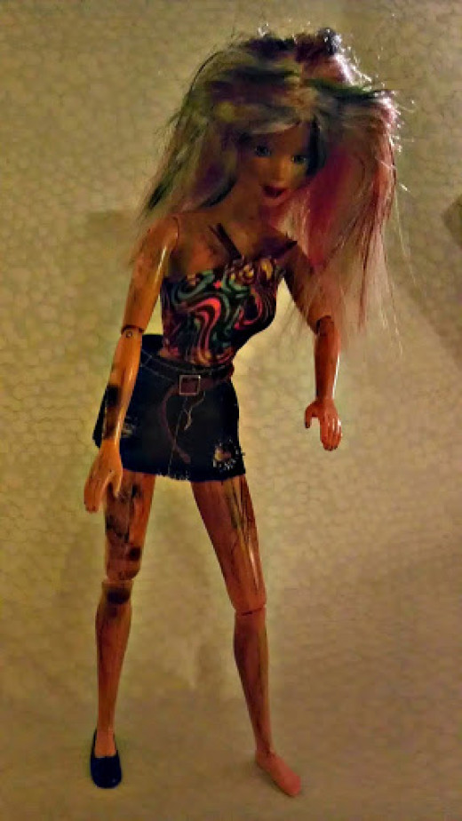 Barbie, a lovely zombie. She stands on her own, but she did lose a shoe.  Probably from running after her next meal!