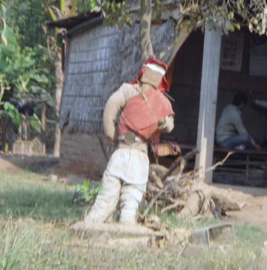 Tiamong are Cambodian scarecrows set outside the home to ward off evil spirits and sickness