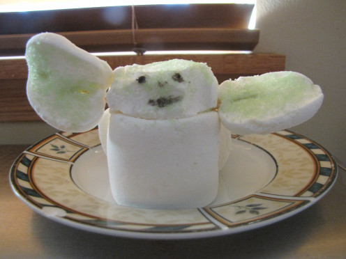 Roll sticky parts of head and ears in green sugar and add eyes and mouth with black food coloring.