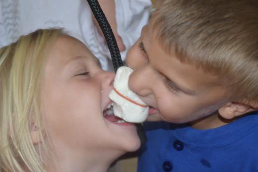 Children enjoying a marshmallow eating contest