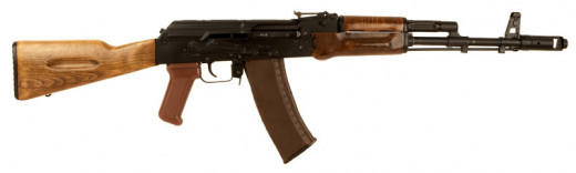 This is the AK-74, usually identified by the muzzle brake, and a very good design too. Other than that the visual obviousness dimnishes unless you notice the magazine differences or field strip them.