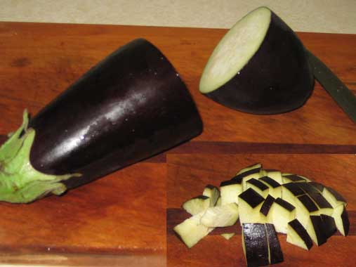 Chop a quarter of a large sized eggplant in chunks.