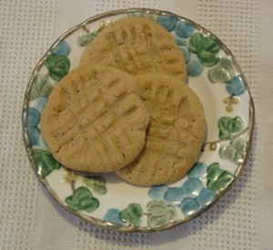 In that photo you can see those distinctive fork marks on the peanut butter cookies. Do you know how those fork marks first got on the cookies. It was in the 1933 Pillsbury Cookbook that people were told to make the marks on peanut butter cookies.