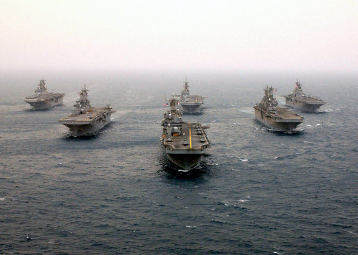 Six modern amphibious assault ships of the US Navy in formation