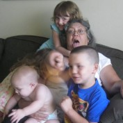 """A lovely """"granma"""" of 10 grandchildren!!!   Isn't that photo just as cute as can be . . . one can tell all her grands want to be as close to their """"granma"""" as can be no doubt!"""