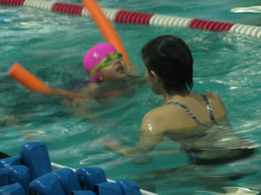 swimming towards the instructor