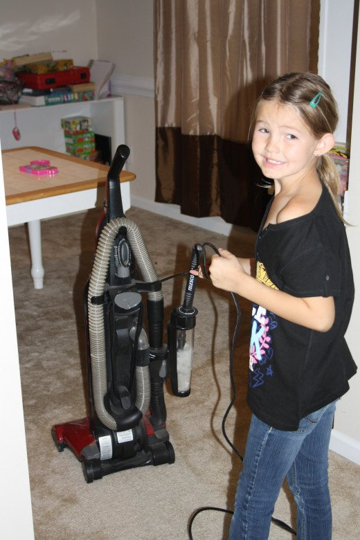 My oldest getting ready to vacuum.