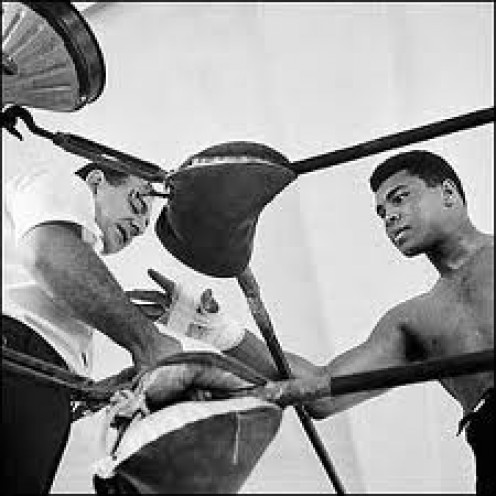 Angelo Dundee trained Muhammad Ali for 90% of his pro boxing career. Ali was a true motivator and knew how to work a corner and make adjustments.