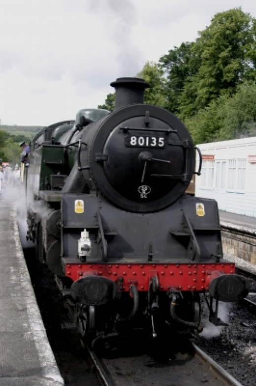 Image Courtesy of Tom Curtis / FreeDigitalPhotos.net   Old Steam Locomotive, similar to ones used in England's rail mania.