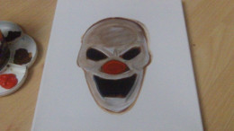Titanium White watered down wash over the entire clown face.