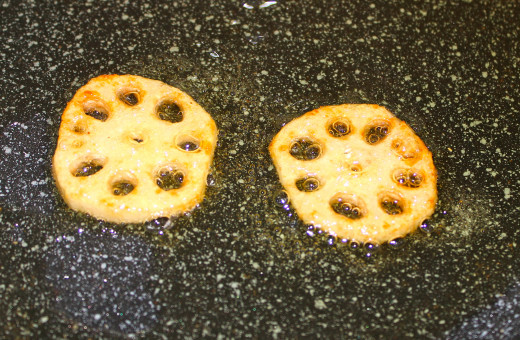 Lotus root sliced and fried in olive oil over medium heat.