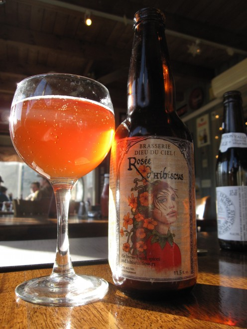 A bottle of Rosée d'Hibiscus from Brasserie Dieu du Ciel in Montreal, Canada. The Rosée d'Hibiscus is a 5% abv spiced ale.  tea-like flavour, a bit tart and with the hibiscus flower really present. A dry, tea-like finish.