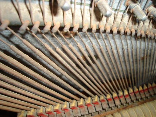 The bass strings on a piano