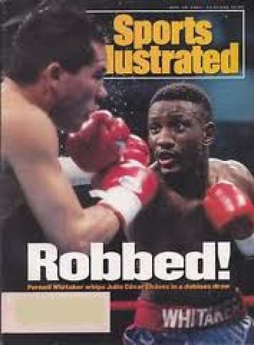 Pernell Whitaker gets a draw with J.C. Superstar in a bout that Sweet Pea clearly won.  Whitaker was a master defensive wizard.