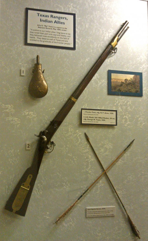 A ball and powder percussion rifle and arrows from Lipian Apaches, who cooperated with the Texas Rangers.