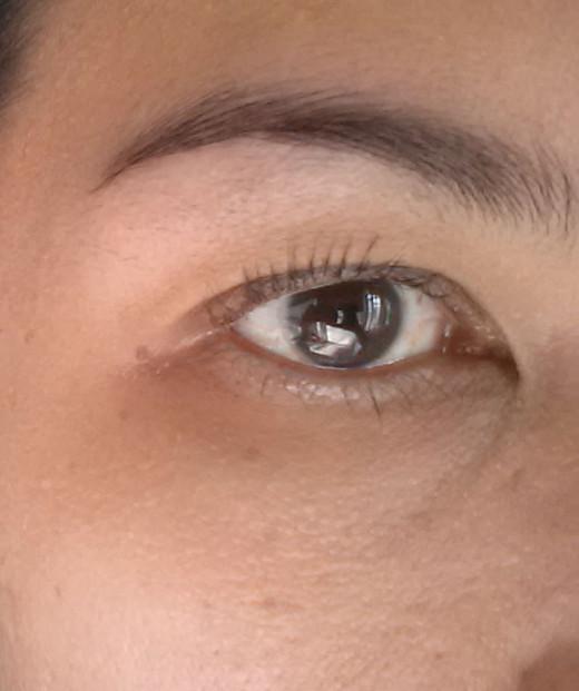 After brushing eyebrows, applying mascara and soft eyeliner