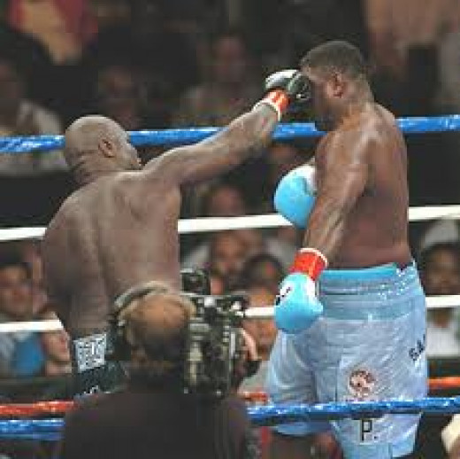 J.T. Hits Samuel Peter fighting as a Heavyweight in their first bout. He also beat Evander Holyfield as a heavyweight.