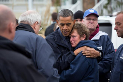 Being Presidential by comforting a victim of Hurricane damage!