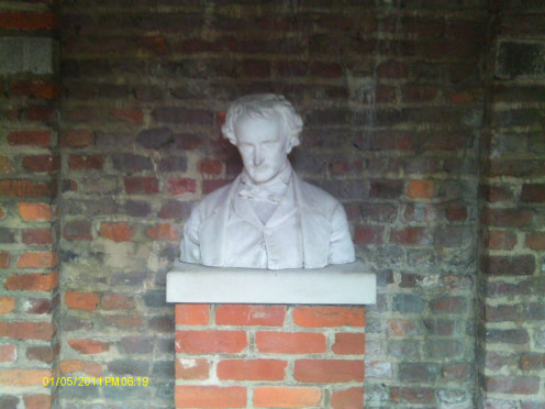 A bust of Poe sits within the shrine