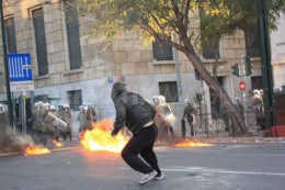 Sometimes protesters fight back such as in this anti-austerity protest in Athens Greece.