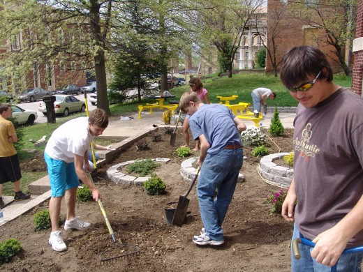 Students work on a landscaping project.
