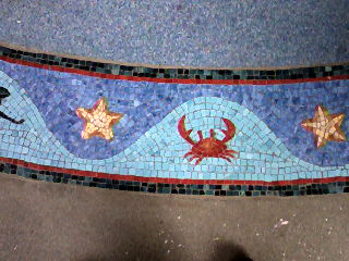 Floor mosaic at the entrance.