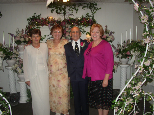 Marvin with Deb and Me on each side and Hildi, his last bride