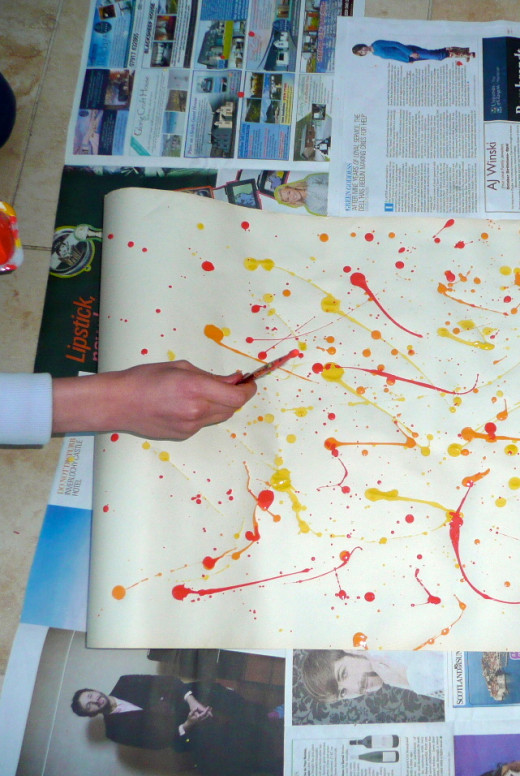 In splatter painting the brush never touches the paper!