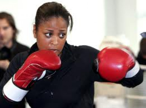 Laila Ali working out in the gym.  Muhammad Ali's daughter used boxing to springboard her celebrity and her career.