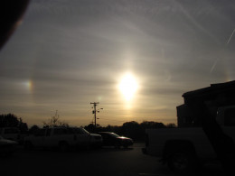 I love how every unusual phenomenon involving our Sun is easily explained with ice crystals in the Ionosphere and Sun dogs. Notice the planet off to the left near the power line at 8 o'clock . . . ?