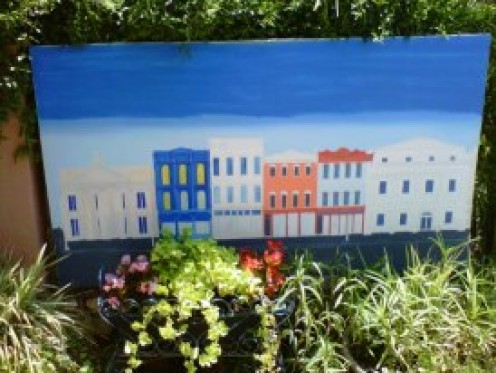 Artists love to capture the vibe of the city and especially Rainbow Row!