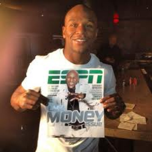 Mayweather on the cover of ESPN The Magazine being flashy. Mayweather has won titles in five weight classes and has rarely lost more than a round per fight.