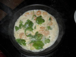 Potato soup with shrimp and spinach