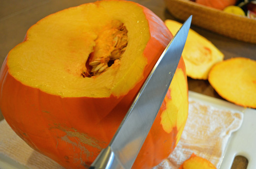 Using a sharp knife, remove peel from pumpkin.