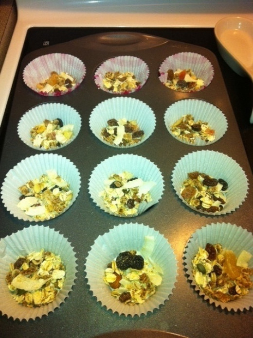 Line a muffin tin with paper liners.  Put a layer of granola on bottom.