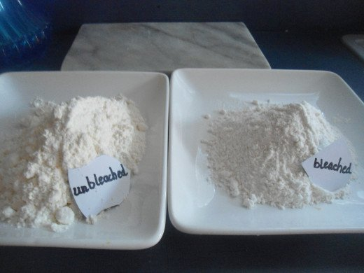 It is kind of difficult to see but unbleached flour has a dull appearance next to the bleached.