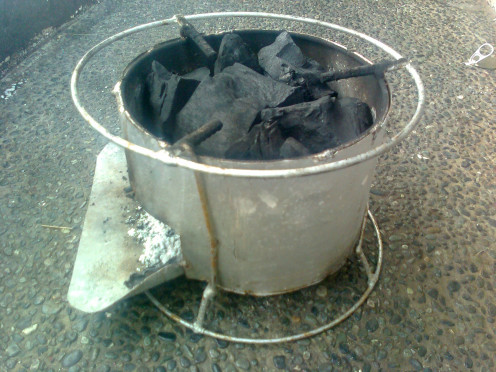 A $5 Dollar Charcoal Stove, 8 inches tall, and 6 inches in Diameter. So portable, in case you need to grill something in the beach, or when doing camping, etc.