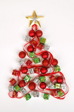 Or you could paste small ornaments on green cardboaard and hang it up.
