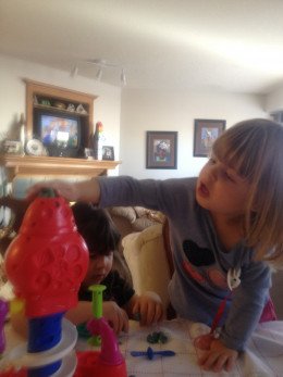 3-Year Old Niece Stuffing The Top With Play-Dough