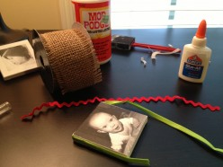 Decorate your photo with ribbon or other craft supplies to turn them into hang-able pieces or ornaments.