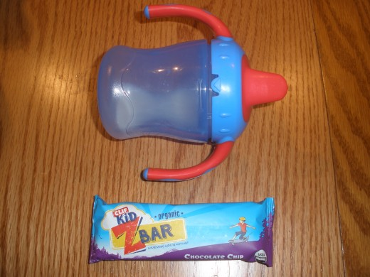 Showing the size of a Clif Z bar using a sippy cup for scale (I figure all parents will be familiar with the size of a sippy cup!)