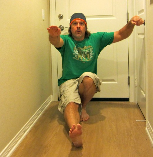 Resting front leg while using door handle for support in the single leg squat