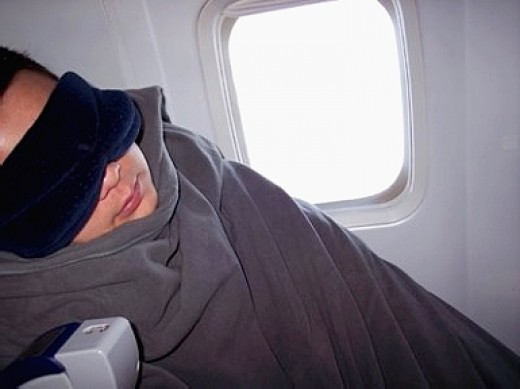 Being well prepared for sleeping on an airplane helps.